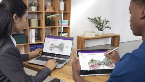 Two associates collaborating and editing architectural illustration using Windows