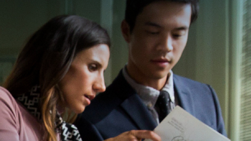 Two people looking at a paper