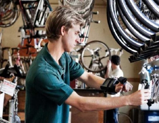 Person working on bikes